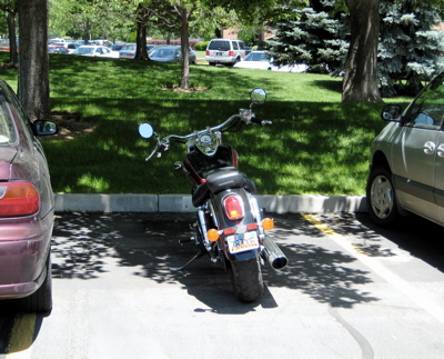 Motorbike takes advantage of inconsiderate parking